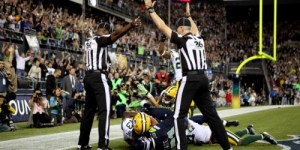 Controversial and conflicting calls at end of Seahawks and Packers game.