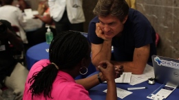 Dr. Oz talks to a woman about her health as part of his national 15-minute physicals.