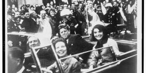 President John F. Kennedy and wife, Jacqueline, ride in a motorcade in Dallas just before his assassination.