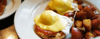 Organic Eggs Benedict and potatoes at Busboys and Poets.