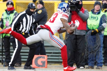 Jan 8, 2017; Green Bay, WI, USA; New York Giants wide receiver Odell Beckham (13) drops a pass in the end zone against the Green Bay Packers in the first quarter in the NFC Wild Card playoff football game at Lambeau Field. Mandatory Credit: Jeff Hanisch-USA TODAY Sports