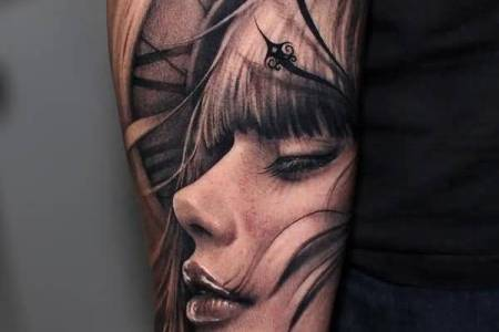 crazy cool smiling girl face and 3d clock tattoo on lower sleeve ?w=760