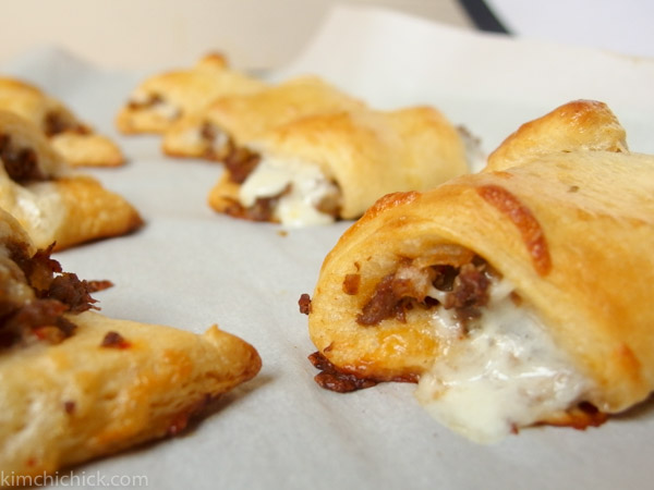 these crescents filled with ribeye steak, fried onions, kimchi, and cheese make for the perfect game day snack!