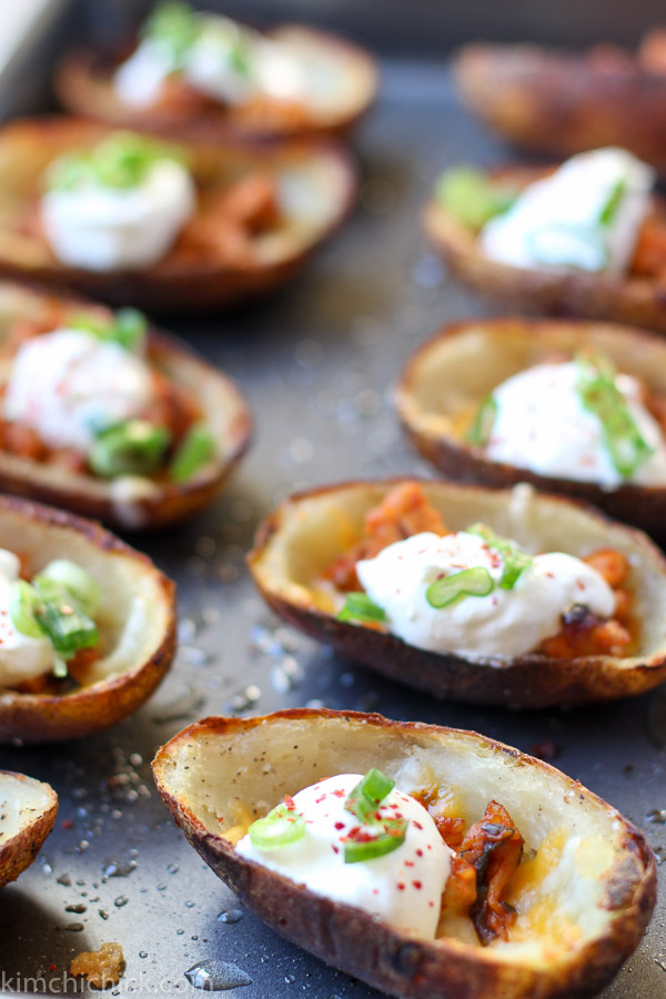 Spicy Pork Kimchi Potato Skins pair perfectly with an ice cold beer. Add these to your BIG GAME DAY spread. Spicy pork and kimchi tucked into a salty, crispy potato skin. SO good!!