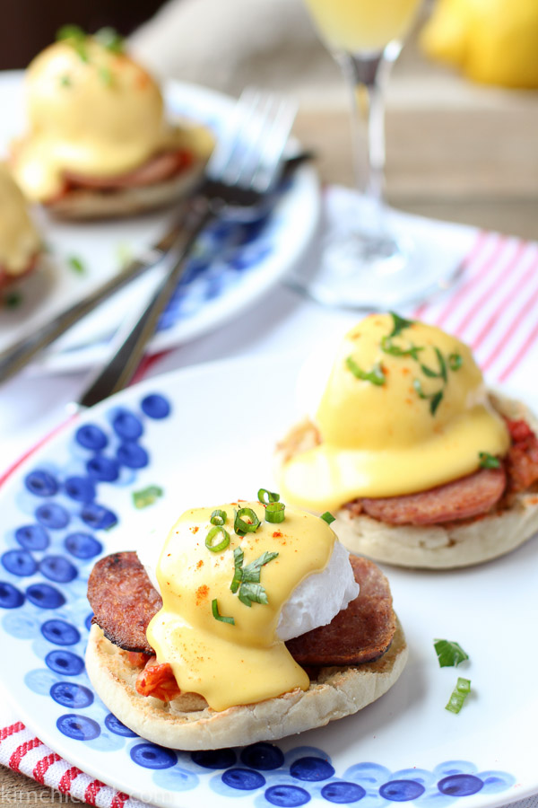 Korean Eggs Benedict is an awesome twist on a classic dish. Gochugaru hollandaise sauce, kimchi, spam and a poached egg makes this the tastiest brunch and best hangover cure all wrapped in one.