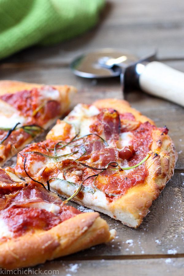 Kimchi Prosciutto Pizza is spicy, salty, smokey and extremely addicting! Gochujang and kimchi make this pizza extra tasty. Trust me, it'll be a huge hit at your next pizza party |kimchichick.com