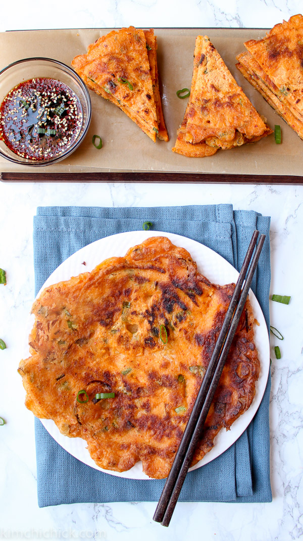 10 minute easy Kimchi Scallion Pancakes are always a crowd favorite. Seltzer water and rice flour are the secret to a crispy outer crust! www.kimchichick.com