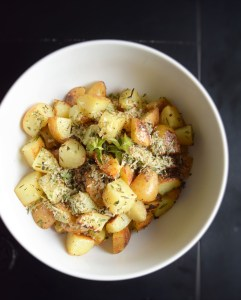 Parmesan and Herb Grilled Potato Salad Finished in serving bowl http://17thstreetkitchen.com/wp-content/uploads/2016/05/DSC_2212-2.jpg