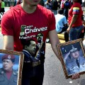A man hawks framed pictures of the late Venezuelan President Hug