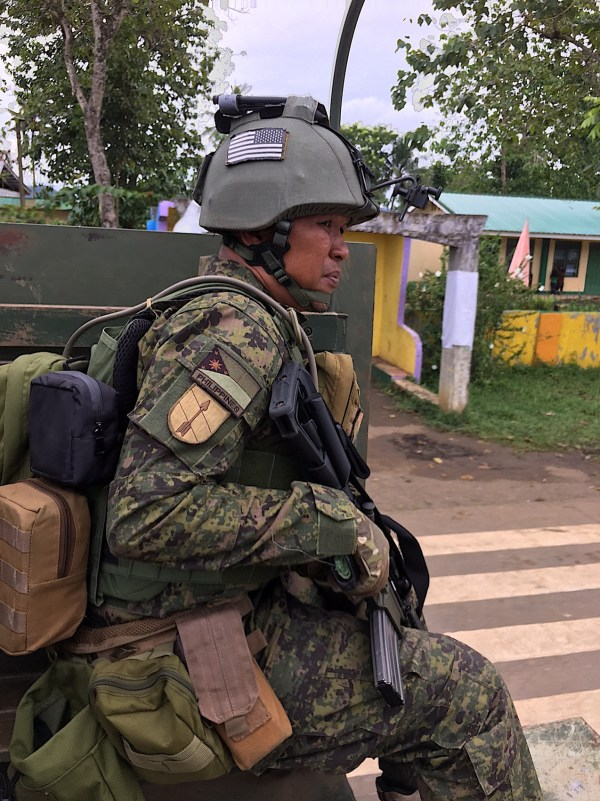 Filipino soldier going to action with second hand US helmet