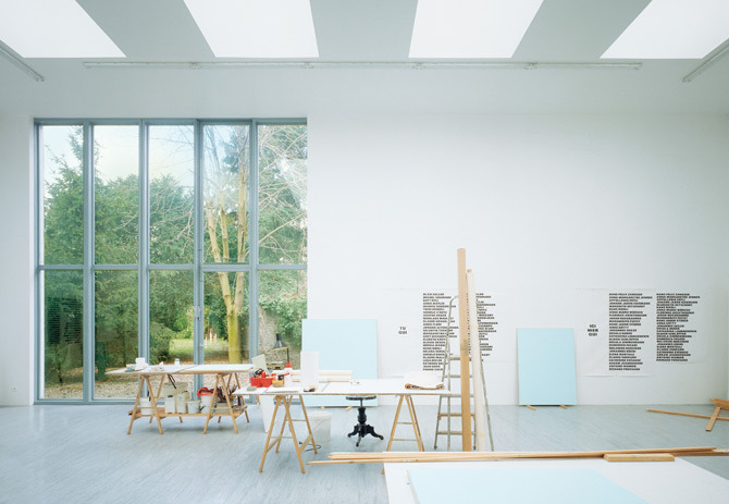 Studio for Remi Zaugg: The resulting studio functions equally as the artists place of work and as a place to present and view art, i.e. a small museum. As an exhibition space, the studio was a kind of prototype for the planning of the Tate Gallery of Modern Art, having given us the first opportunity to try out the concept of overhead lighting, projected for the museum in London. This overhead lighting is so simple that one wonders why it hasnt been used in museum architecture before. Is it too simple, too primitive or not distinctive enough to bring out the individuality of the designing architect? Actually, the opposite is true. Thanks to its almost spectacular simplicity, the exhibition space acquires a peacefulness and concentration to which we are hardly accustomed in conventional museum spaces with their all-glass ceilings, suspended overhead lighting or ceiling grids. Designed by Herzog &amp;amp; De Meuron. ViaWorkspaces.
