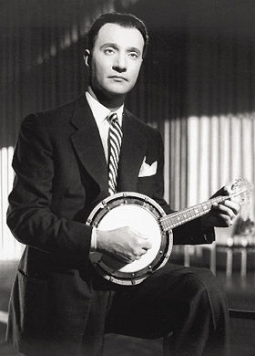 Muslim Mohammed Abdel Wahab is seen here wearing a fetching suit with his beloved Turkish cümbüş mandolin.