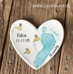Painted heart with toeprint bees