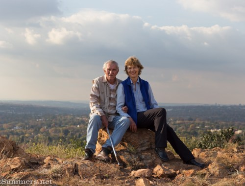 Wendy and David sitting on the Melville Koppies