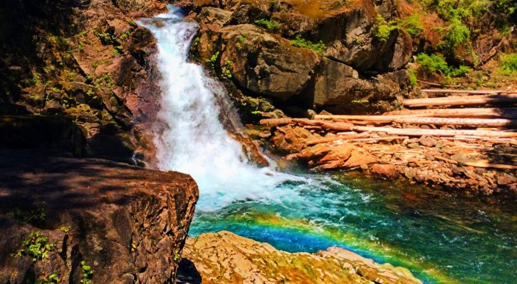 Clear water and colorful rocks and rainbow at Silver Falls Mt Rainier National Park 1