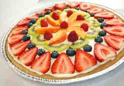 This fruit pizza with cream cheese icing and fresh fruit makes an amazing summer dessert, especially if it's for someone's birthday.
