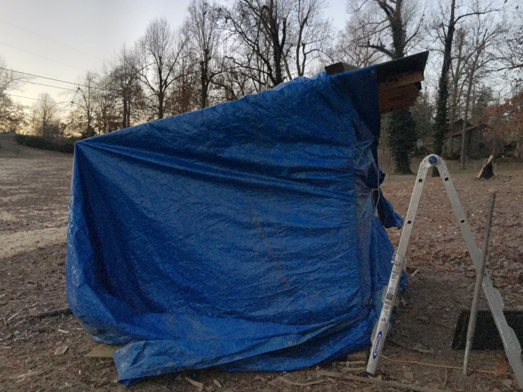 The Coop Wrapped in a Tarp