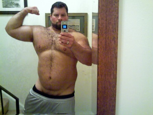 beefy muscle bears flexing