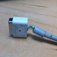 One broken MagSafe power adapter.