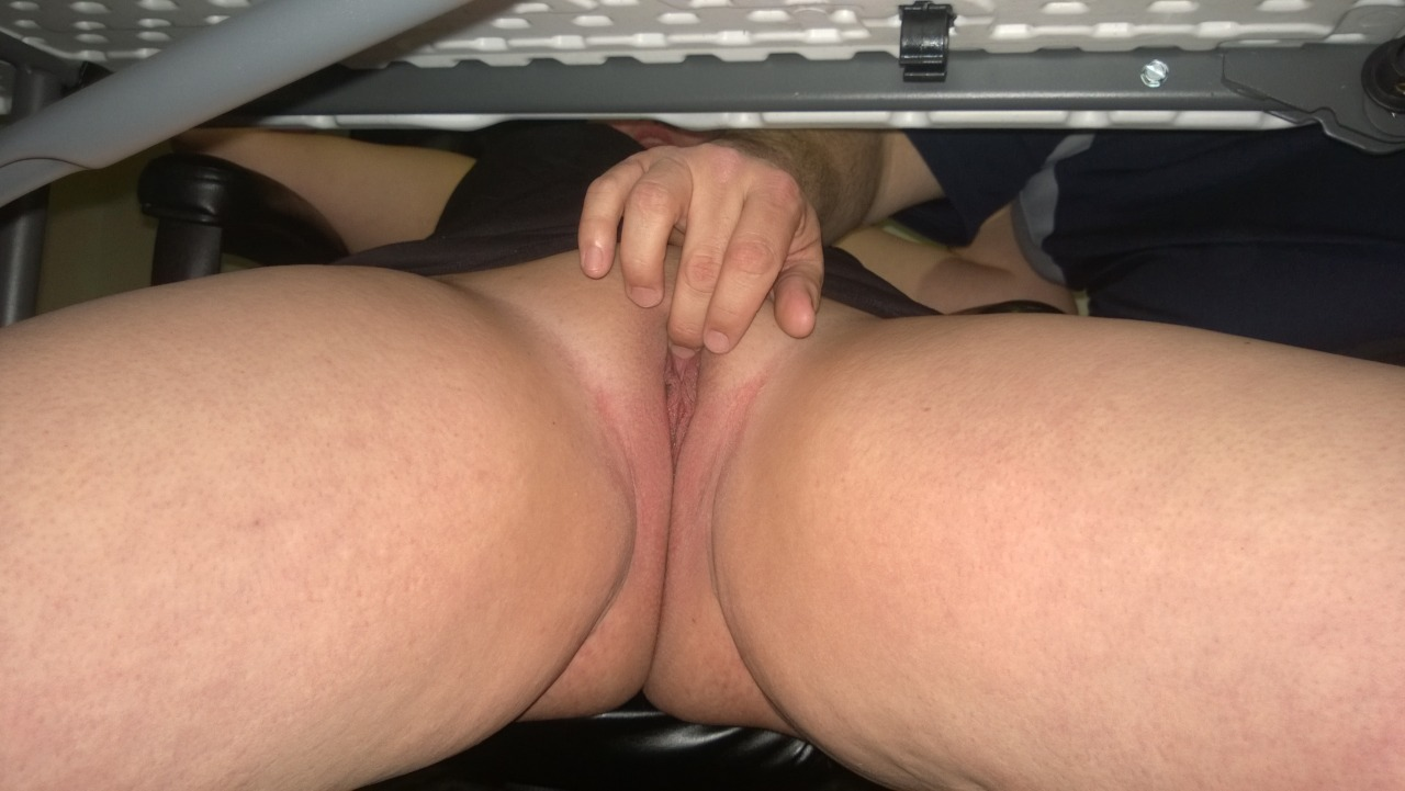 man fingers a pussy in public under a table