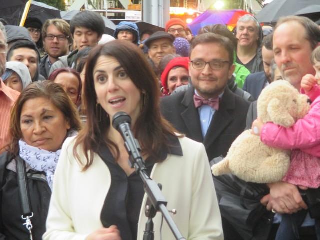 Hillary Ronen addresses a large crowd outside St. Luke's