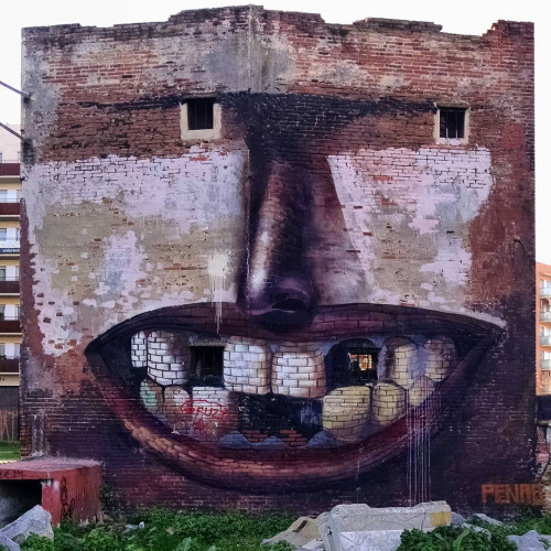 itscolossal:  A Deranged Building Facade on the Streets of Barcelona by Penao