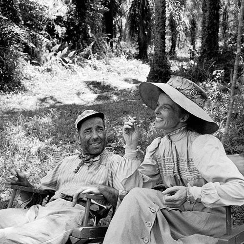 life:  Legendary actors Humphrey Bogart and Katharine Hepburn relaxing on the set of 'The African Queen' in 1951. (Eliot Elisofon—The LIFE Picture Collection/Getty Images) #LIFElegends #1950s