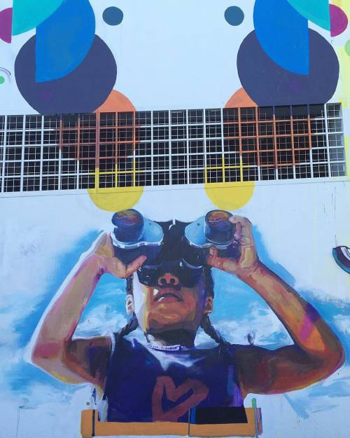 """impermanent-art:  """"Eyes On The Ecliptic"""" by Christopher Jordan. Big mural on NW 5th Ave at NW 36th St. Based on a photo of the artist's niece observing the sky. With support from Artist Trust."""