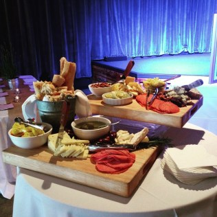 A huge display of local cheeses and cured meats at a rehearsal dinner