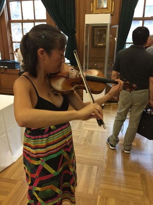 My friend, Steve, took this pic while I blissfully played on the Lady Jeanne Strad at the NYC exhibition by J&A Beare!