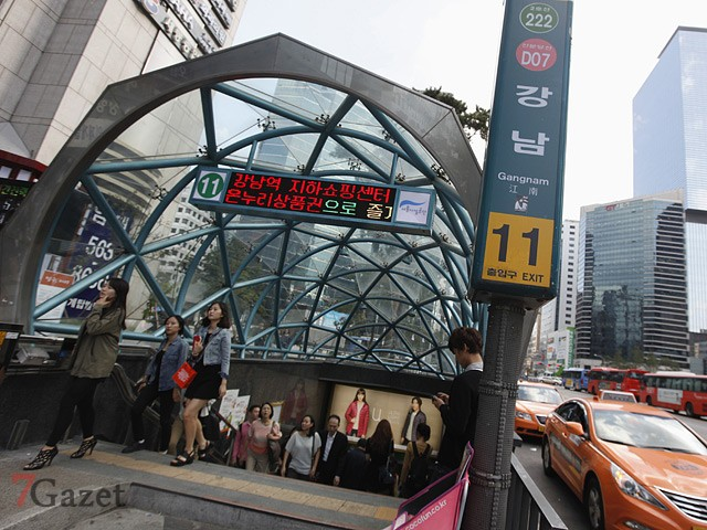 People come out at Gangnam subway station in the Gangnam area of Seoul