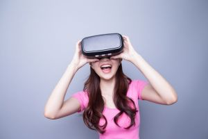 54087366 - excited happy woman watching the virtual reality headset, asian beauty