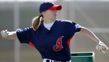 Justine Siegal throws batting practice to Cleveland Indians minor leagueers during baseball spring training Monday, Feb. 21, 2011, in Goodyear, Ariz. Siegal became the first woman to pitch batting practice at a Major League camp. (AP Photo/Mark Duncan)