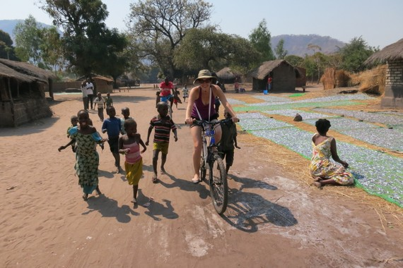 Bike ridding through a village in Malawi