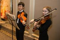 Preparatory Strings students greet guests on the Four Season's Grand Staircase | Photo by Elliot Mandel