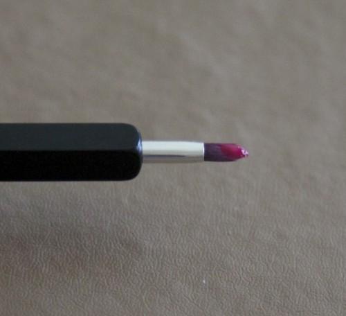 Demure on lip brush