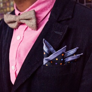 Tan bow tie and blue pocket square