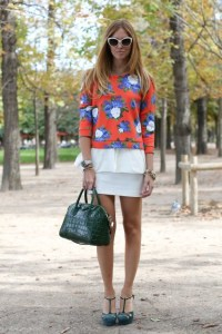 Bold print top with mini skirt.