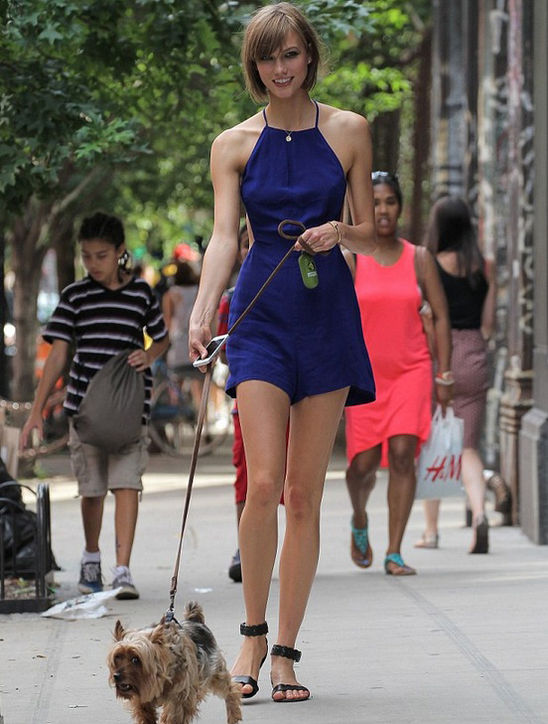 Karlie Kloss wearing a The Reformation romper.