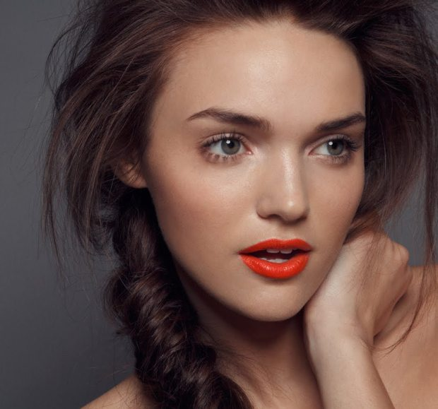model with Bright Orange Lip Color for NYFW 2013