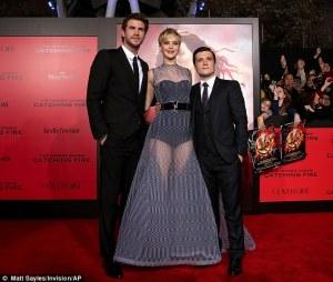 Liam Hemsworth, Jennifer Lawrence, and Josh Hutcherson on red carpet.