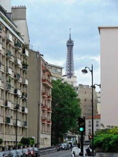 Eiffel Tower peeks above street 2
