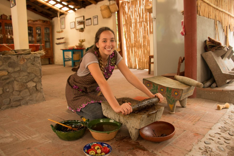 Alana manning the metate as a genuine Zapotec.