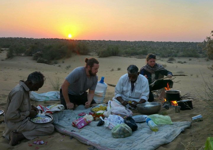 Cooking vegetable pakora in the Thar Desert of North West India with Kheta our guide and his brother, both of whom still live and graze animals here with their families when not guiding camel safaris. (Photo Adam Meeker)