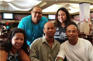 Touch Hak, far right, with brother Puthy, center, and other members of their family.