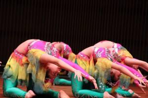 Hmong girls show their flexibility in dance.
