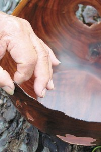 Bob Hamada working on a wood bowl.