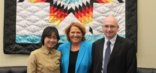 From left, Jin Hee Choi, U.S. Sen. Heidi Heitkamp (D-N.D.) and Mikhail Bobylev.