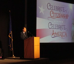 Minn. State Sen. Foung Hawj (DFL-67) welcomes 533 refugees and immigrants who were sworn in as new citizens of the United States of America by Magistrate Judge Steven E. Rau of the United States District Court at the St. Paul River Centre on Sept. 6, 2016. (Contributed photo)