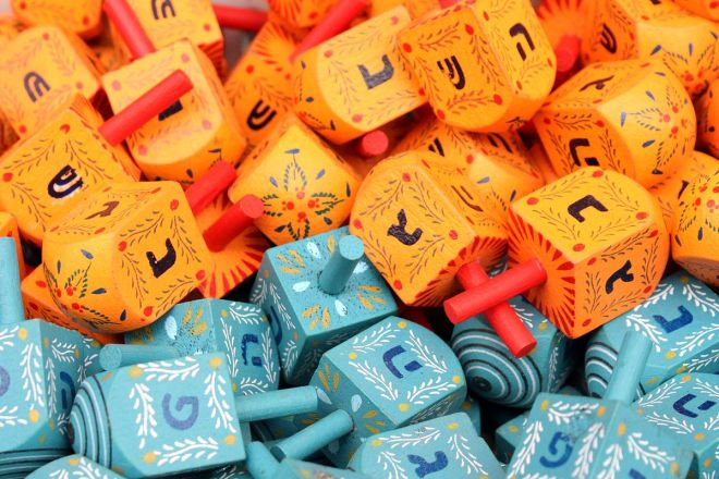 """""""Colorful dreidels2"""" by Adiel lo - Own work. Licensed under CC BY-SA 3.0 via Wikimedia Commons."""